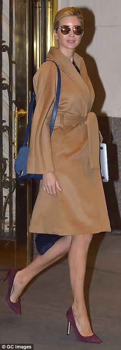 Style star: The 35-year-olddonned a camel-colored wrap coat, maroon pumps, and a $225 blue suede saddle bag from her eponymous fashion line as she headed to work