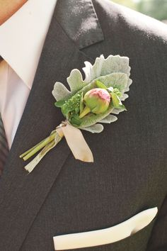 Boutonnieres made of spray garden roses and dusty miller