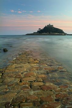 St. Michael's Mount in Cornwall England. You can walk the 400 yards on this stone path partially submerged in water at lowtide.