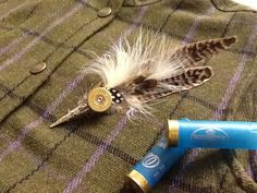 Scottish feather plume brooch, handcrafted on Gumtree. Handcrafted brooch with pheasant and Guinea fowl feathers. Can be worn on lapel or hat and can also