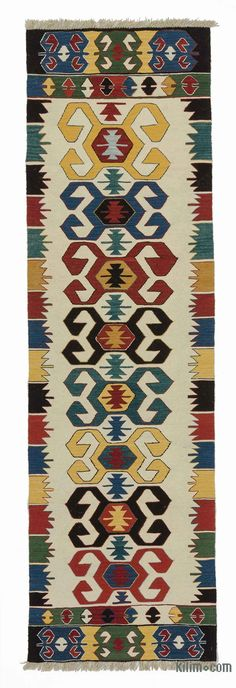 Beautifully transform your living space with our handmade, authentic and timeless new kilim rugs that carry with them many of the traditional elements that made true vintage Turkish Kilim rugs so precious. Each kilim is skillfully hand-woven in Turkey to create a beautiful piece of art. We use vegetable dyed and hand spun wool to make sure they age gracefully.This fine multicolor rug measures 2'8'' x 9'4'' (81 cm x 284 cm). We can customize it by adding your monogram or removing the fringes…