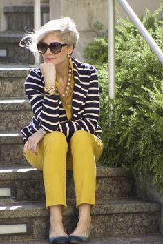 striped jacket and mustard jumpsuit