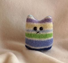Make a pocket cat from an old sweater or glove. I'd make it smaller & put a magnet on the back instead of a tail for a fridge kitty!