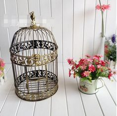 http://es.aliexpress.com/item/Bird-cage-candle-holder-Hand-made-Gold-moroccan-decor-vintage-metal-candle-lanterns-candelabra-bird-cage/32484103413.html?spm=5261.7755889.1998617682.46.uny4Ll