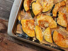 tray of roasted acorn squash with harissa