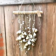 Blij om dit item uit mijn shop te delen: Artisan Ceramic Wallhanging with 28 handmade unique bells and several beads, hanging down from a branch. Wind Chimes, Artisan, Etsy Shop, Ceramics, Beads, Outdoor Decor, Artwork, Handmade, Vintage