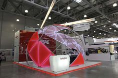The idea of the project - to create a visual image of the helicopter. Negotiation zone, a helicopter simulator and other artifacts were located inside the curved shell. Bright red color, clean design, modern materials and innovative products have become…
