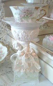 found this exact same cherub base at GW and put a pink rose plate on top!