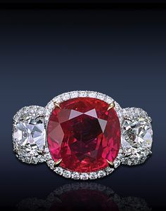 Jacob & Co. | A Magnificent Ruby & Diamond Ring, Composed Gubelin Certified 10.20 Ct. Cushion Cut Pink Red Ruby, Flanked By 2 Cushion Cut Diamonds Framed By 4.40 Ct. Pave' Set White Diamonds, Mounted In Platinum And 18K White Gold. | You can see the Rest of the Outfit and my Comments on this board.  -  Gabrielle