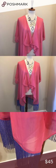 LuLaRoe Monroe Cardigan A sheer cardigan is your perfect spring transition piece. This one is a fun pink with purple tassels. The tapered front and tassels on the bottom make it trendy and adorable with shorts. This is a brand new boutique piece. Make sure to check the sizing chart because it only comes in two sizes 😊. LuLaRoe Sweaters Cardigans