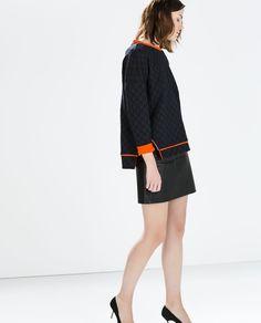 Imagem 1 de BLUSA COMBINADA FECHOS DE CORRER da Zara