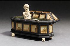 'Memento Mori', ivory skeleton in an ebonized wood coffin. South German, possibly Augsburg, 17th century.