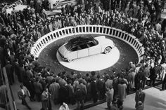 Earth was invaded in October 1955 when the otherworldly Citroën DS 19 made its debut at the Paris Motor Show. The DS was a large and luxurious saloon, with a front-midengine, front-drive layout. The spacecraft-like fuselage was shaped of removable/repairable aluminum panels and a fiberglass top. The car fairly bristled with innovation, including the famous hydropneumatic self-leveling suspension. Legend has it that by the end of the first day of the Paris show the company had taken 12,000…
