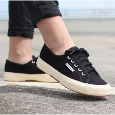 Superga Black Canvas Cotu Sneakers Black cotton canvas sneakers with a low profile design and a textured contrast sole.  Classic style loved by bloggers and celebs (MK and A & Alexa Chung!). These run a little big and would fit a wide 7.5 but will also work for a normal or narrow 8.  Excellent condition, gently worn, only shows wear on soles. NO TRADES/PAYPAL. Superga Shoes Sneakers