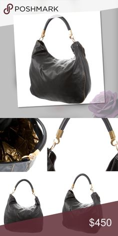 """Yves Saint Laurent Roady Hobo Gold Side Trim! Black leather Yves Saint Laurent Roady hobo with gold-tone hardware, single rolled shoulder strap, metallic gold-tone coated nylon lining, three pockets at interior walls; one with zip closure and magnetic snap closure at top. Includes dust bag. Height: 15"""" Shoulder Strap Drop: 7"""" Depth: 5"""" Width: 16"""" Excellent Condition No visible signs of wear. Authenticated and DB included.  Photos of actual bag!! Yves Saint Laurent Bags Hobos"""