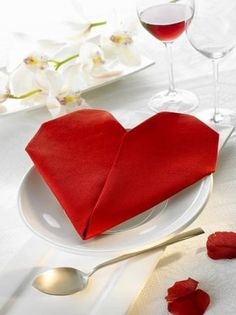 A red heart shaped napkin folding for Valentine's Day