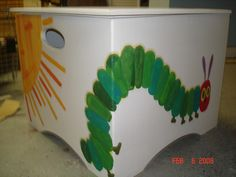 Pages from the Hungry Caterpillar painted on all sides of a toy box!