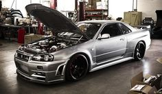 R34 Nissan Skyline...there's a garage spot reserved for one of these...in my future garage...