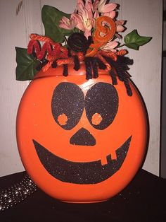 Save laundry detergent pods and upcycle them into the cutest pumpkin ever!