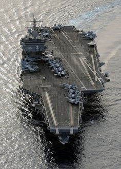 The aircraft carrier USS Enterprise (CVN is underway in the Atlantic Ocean during a composite training unit exercise. Navy photo by Mass Communication Specialist Seaman Eric Scot Brann/Released) American Aircraft Carriers, Navy Times, Uss Enterprise Cvn 65, Navy Aircraft Carrier, Us Navy Ships, Navy Military, Air Force, Train Layouts, War Machine