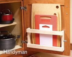 Cutting Boards Make a small rack for storing all of your cutting boards behind the door – you'll just need a few pieces of wood.