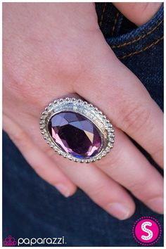 A large purple gem with faceted edges is adorned with an intricate silver border for a vintage style. www.paparazziaccessories.com/vegasbling