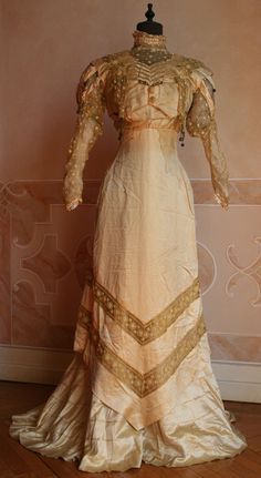 1909 - 	    Golden yellow silk dresses with lace inserts of the same color.