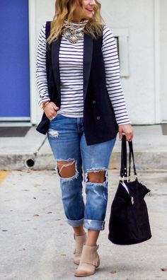 Fashion blogger outfit idea - Wearing Zara ripped boyfriend jeans with a striped turtleneck from Madewell and a black vest from Topshop