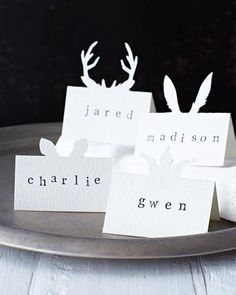 Animal ears silhouette place cards for a woodland wedding - you could use the same idea for Alice in Wonderland shapes...