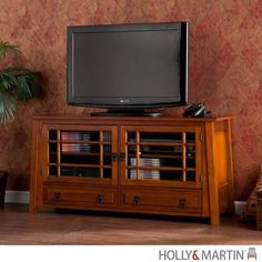 Holly and Martin Harrison TV_Media Stand-Brown Mahogany - HM-63-118-055-6-20. Holly and Martin Harrison TV_Media Stand-Brown Mahogany - HM-63-118-055-6-20 Fall in love with the lightly Asian-inspired, linear design of this TV_media stand. The warm, brown mahogany finish and ample storage make this media .. . See More TV Stands at http://www.ourgreatshop.com/TV-Stands-C671.aspx
