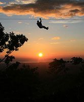 zipline costa rica.  great photo.  imagine being bigger than the sun?