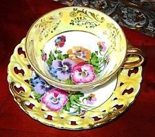ROYAL SEALY 3 FOOTED YELLOW IRDESCENT PURPLE PANSY PIERCED TEA CUP AND SAUCER P
