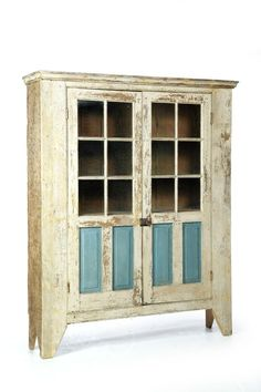"UNUSUAL WALL CUPBOARD.  Attributed to Michigan, 1st half-19th century, walnut, butternut, and chestnut. One-piece cupboard with the full door have six panes over raised panels. Retains old white and blue paint. 73""h. 60""w. 15""d."