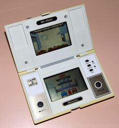 Vintage Nintendo Oil Panic Electronic Handheld Game, Part Of The Game & Watch Series, Model OP-51, Made In Japan, Copyright 1982.