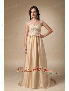 Gold Column Sweetheart Brush Train Taffeta Ruch Prom Dress  www.fashionos.com  This champagne dress features a pretty sweetheart neckline and cap sleeves that are heavily embellished with intricate artificial pearl accents. The bodice texture is crisscrossed in a lovely whirlpool pattern of taffeta fabric that adds lots of visual interest to the design. The floor-length skirt is light and airy so that it moves beautifully when you walk.