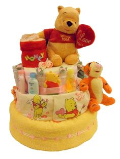 Pooh Baby Shower Gift idea http://babydiapercakesngifts.wordpress.com/2010/10/27/disney-pooh-and-tigger-diaper-cake/