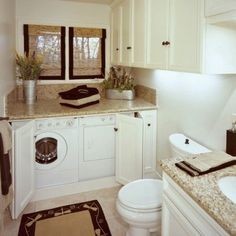 bathroom laundry room combo - like how easily disguised the washer/dryer are and still a spacious bathroom.