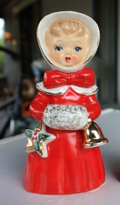 Christmas caroling girl, dressed in her finest, out for a stroll. Made in Japan during the 50s, she is approx. 5 high, with gold detail on her red dress and bonnet. Excellent vintage condition, with original clapper intact. Minimal paint loss and crazing, which is typical in cold painted items from Japan.  I am paring down my enormous Christmas collection, with hundreds, if not thousands, of vintage items, as well as many other collectible treasures. Check back often as I will be adding…
