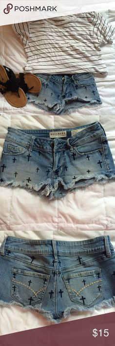 Bullhead frayed shorts Bullhead short shorts from Pacsun that feature crosses and frayed bottoms. They have been put to some good use, but don't necessarily have any flaws besides being a bit worn down. Feel free to message me with any questions and/or offer me a price! :) #shorts #pacsun #bullhead Bullhead Shorts Jean Shorts