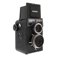 Lubitel 166+ — uses 35mm and 120 film, old-school drop-down viewfinder, & offers 4 different photo formats