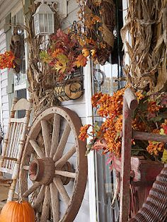 fall decorating.. never thought of doing this around my wagon wheel...love it!