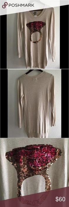 "Pink Boutique Ring Sequin Sweater Tan Sz M/L NWT Antique Cooper & Pink tone ring-sequin on front Scooped neckline Long sleeves Relaxed fit at bodice, hugs hip and thigh. Pullover style.   Machine washable or dryclean Retail price: $168 NWT  Material: Viscose / Nylon Size:  M/L Bust: 17"" Length: 31""  You can also wear with jeans or over leggings/tights so there are lots of options.  My home is smoke & pet  free Pink Boutique Sweaters Crew & Scoop Necks"