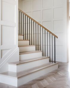 Panneled walls and a wrought iron balustrade in a Texas home by Coats Homes and Turney and Associates Architects Photo by Costa Christ Stair Handrail, Staircase Railings, Staircase Design, Stairways, Banisters, Spiral Staircases, Handrail Ideas, Modern Staircase, Modern Stair Railing