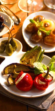 Tapas | Enjoy delectable small plates from Royal Caribbean's Vintages. Pictured is an array of Zucchini, brussel sprouts, and cherry tomatoes.