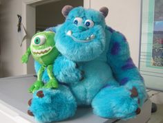 Going to use this photo of monsters inc toys as a guide to make a cake