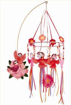 This gorgeous Merry Go Round wall mobile from Djeco is a beautiful way to decorate your child's room or nursery. Designed with reds and pinks, the mobile features various bird and flower details that you can watch fly gently with a breeze. Impression 3d, Ribbon Mobile, Dream Catcher Mobile, Hanging Mobile, Merry Go Round, Toy Craft, Unusual Gifts, Kids Bedroom, Envelope