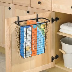 This iDesign Axis Over the Cabinet Waste/Storage Basket fits over cabinet doors to provide storage or space for disposing food waste. Compact basket is made of steel wire with bronze plating. Foam backing on the hooks protect your cabinets. Kitchen Organization Pantry, Diy Kitchen Storage, Home Organization Hacks, Storage Hacks, Diy Storage, Storage Ideas, Organizing Tips, Under Cabinet Drawers, Cabinet Doors