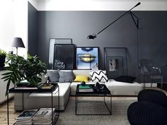 I love the lamp and minimalist tables, as well as the wall art (or more like the art leaning on the wall). The grey floor is also very sleek and rustic-modern looking