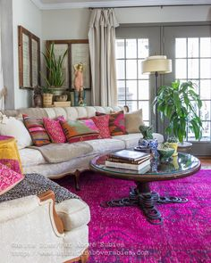 Far Above Rubies: Bohemian Chic Spring Home tour; gorgeous living room with pink textiles