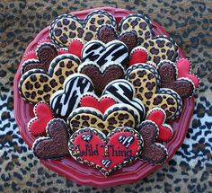 Oh my gosh!!!  Wild Thing Valentines day heart cookies with cool animal prints and lacy brown embroidery!